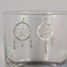 -925 Sterling Silver Handmade Dreamcatcher Earrings  -Earring Size - 5/8 x 1 1/2-inches    I have always loved dreamcatchers. And I've thought that keeping one close to you is a good way to remind yourself to keep dreaming and only allow the good thoughts that serve you to take root in your heart.    I make each little dreamcatcher from sterling silver wire and the mesh is woven by hand so no two are exactly alike. The total height of the earring is 1 1/2-inch including the hook and the…