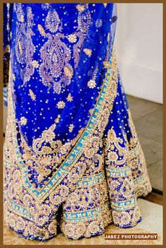 Love the blue color and detailed embroidery at the bottom of this wedding lengha. Perfect for any engagement party!