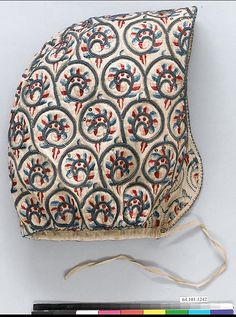 Coif Date: 1600–1630 Culture: British Medium: Linen worked with silk and metal thread, spangles; satin, long -and-short, braid, buttonhole, and couching stitches Dimensions: Coif: H. 9 x W. 8 1/2 inches (22.9 x 21.6 cm); Forehead cloth: H. 7 x W. 17 1/2 inches (17.8 x 44.4 cm)