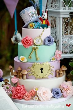 Alice in Wonderland Whimsical Mad Hatters Tea Party Wedding Cake with sugar flowers and sugar details
