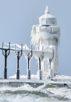 icy piers and frozen lighthouse; Saint Joseph, Michigan; Jan 2013