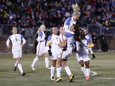Allie Long and teammates after Long scores with a header vs. Colombia, East Hartford, Conn., April 6, 2016. It was her first international goal and fifth cap. (Mark L. Baer/USA Today Sports)