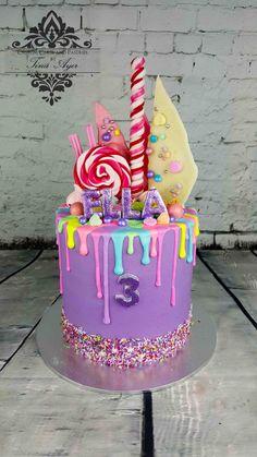 Purple rainbow drip cake