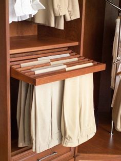bedroom closet storage solution: wooden pull-out pants rack