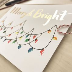 These lights were so much fun to paint! Here's another holiday card that will soon be available on my Etsy Shop!🌲❤️❄️  .  .  .  #greetingcardsofinstagram #greetingcards #etsyowner #etsyshop #handlettering #holidayseason #holidaycard #merryandbright #etsyohio #etsyowner #etsysellersofinstagram #etsychristmas #etsycardshop #etsycards #watercolor #greetings #tombowusa #watercolorchristmas
