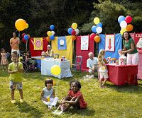 Do it yourself carnival decoration (tables backed with simple plain cloths in different colors plus balloons)