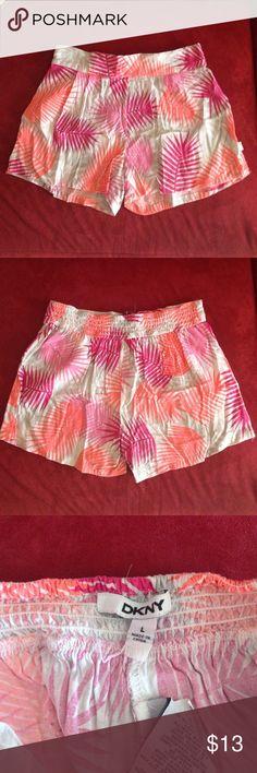 Girls DKNY floral print shorts Large Make offer! Lightly used girls floral print DKNY shorts size Large kids DKNY Bottoms Shorts