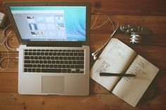 Macbook and notebook stock image By Galymzhan Abdugalimov.JPG