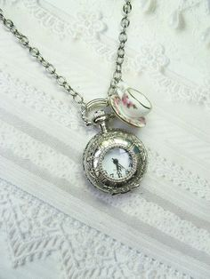love the miniature teacup.....I love wearing watch necklaces with a little charm....:)