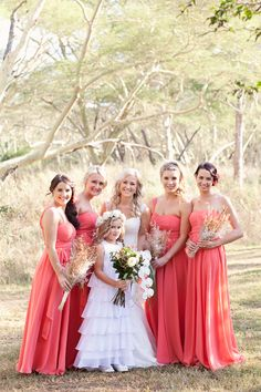 Coral dresses look great. Compliment outdoor photos well.