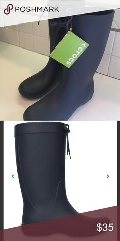 CROCS freesail rain boots, navy, relaxed fit, 9 A new pair of Crocs freesail rain boots, navy, size 9, rubber, relaxed fit at calf. CROCS Shoes Winter & Rain Boots