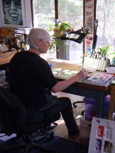 Cynthia Reid, watercolorist, in her studio