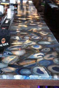 Looking to backlight your stone? Check out our LED light panels // Caesarstone Concetto Profondo 8531 bar top- made from semi-precious stones. Visit globalgranite.com for more countertop options.
