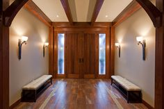 Luxury Timber Frame traditional entry featuring Hubbardton Forge Wall Sconces. tdSwansburg Design Studio