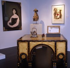 Double-Sided Desk by Carlo Bugatti, (circa 1900), painted parchment, ebonized wood, pewter and brass inlay, hammered brass, bone on two sides with single frieze drawer flanked by cabinets containing three drawers, 31 ½ inches high, 55 1/8 inches wide, 40 1/8 inches deep