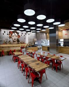 In a first joint foray into restaurant design, New York architecture firm ODA, and branding agency IF Studio, create Satya Eastern Kitchen. In creating Satya Eastern Kitchen, ODA begins at the core -- the gathering of people and the cultural influences Cafe Bar, Cafe Restaurant, Restaurant Design, Restaurant Seating, Chinese Restaurant, Fast Food Restaurant, Design Commercial, Commercial Interiors, Asian Restaurants