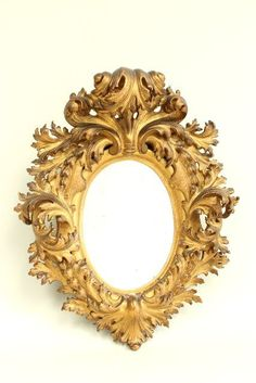 """19th century carved gilt wood frame Approx. 22"""" H x 18"""" W. Fits approx. 10 1/8"""" x 7 1/8"""""""