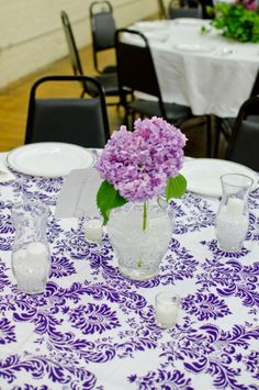 this printed tablecloth really pops with color, dresses up the white china