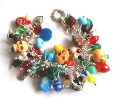 Day of the Dead Dia de Los Muertos Frida Kahlo style loaded Charm Bracelet Treasure Bracelet Vintage beads Skulls. $229.00, via Etsy.