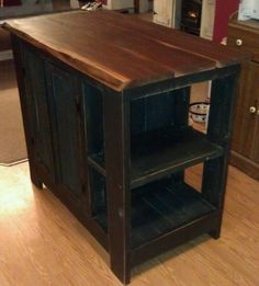 Custom kitchen island made with reclaimed barn material, pallet material and live edge walnut counter top
