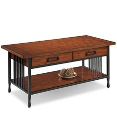 Center your space with inspiration from a rustic lodge along a snowy mountainside by adding this classic coffee table into your home. For a contrasting look, it pairs a blackened metal frame with medium oak-finished wood designs. While its tones are versatile, it's sure to grab a few glances with its slatted sides, distressed wood grain details, and curved feet. Pair it with a southwestern-printed rug for a fine foundation in the living room, then up the weathered appeal with a well-worn ...