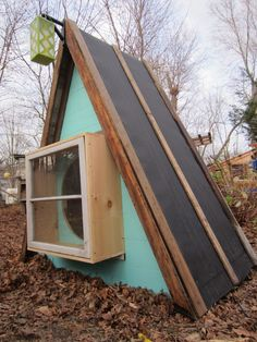 Tiny recycled a-frame cabin? Cool bump-out window