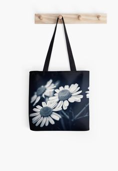 A patch of wild daisy flowers in black and white. Macro flower photography • Also buy this artwork on bags, apparel, stickers, and more.