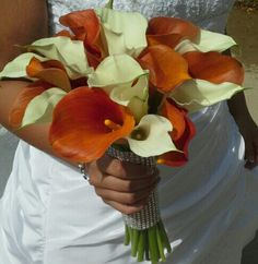 Orange and white calla lilies with diamond covered handle