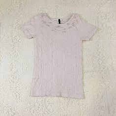 Stylish Lace Stretch Tee Shirt! Stylish Lace Stretch Tee Shirt! White with a slight pink hue color, size small. Bundle & save with my discount! Tops Tees - Short Sleeve