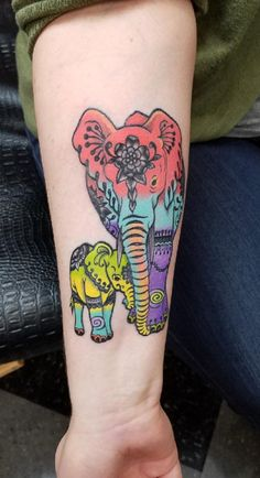Elephants tattoo. Momma and baby. By Melanie at Mantis Tattoo in Jeannette, PA #evamigtattoos #tattoo