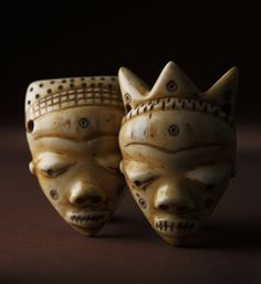 Africa    Ivory amulet ikhoko Pendants from the DR Congo.   These type of amulets are often worn around the waist.
