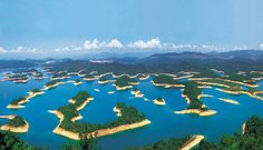 Qiandao Lake, China. In Chinese it means:  Lake of the Thousand Islands, is an artificial lake formed after the conclusion of the hydro hydro of the Xin'an river in 1959
