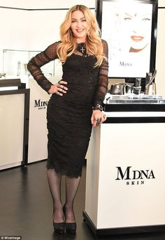 Keeping distracted: Madonna appeared to be in content spirits as she promoted the new MDNA...