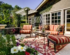 Extend the warmth of home to the patio with a bright area rug.