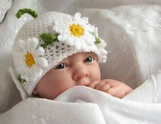 433d334bbef This is a crochet pattern for a pretty little hat with a garland of  daisies. It is a multi-sized pattern in four sizes designed to fit from a  newborn baby ...