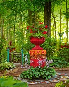 Fantasyland in a wooded garden with colorful mosaics and repurposed objects. This is unusual & pretty!