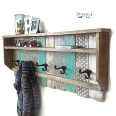 Entryway Shelf Coat Rack made from Reclaimed Wood with Cast Iron Coat Hooks ~ Bohemian Decor  Functional Artisan Distressed Shelves - perfect for the entryway or bathroom. Made with reclaimed wood, painted grays, and turquoise aqua and distressed, with antiqued heavy cast iron double hooks. There are 2 shelves 3 and 4 deep with heavy keyhole hardware on the back (16) which makes for a simple, strong installation. All hardware included. Measurements: 33 x 14 x 4 5 hooks Need a different size?…