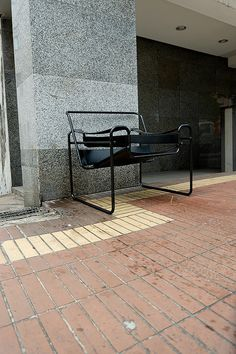 It's like the chair was fired and told the leave the building. But once it exited it had no where to go so just sat outside and cried.    I like how the chair suits its environment. Also out of all the old abandoned chairs I've seen I doubt this was ev