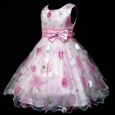 flower girl dress- white sleeveless dress with light pink flower and light pink ribbon with a bow around the waist