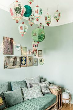"chinese paper lanterns in green room / sfgirlbybay - ""my very much beloved and favorite decor magazine milk decoration just featured the exotic and uber-eclectic paris apartment of sophie duruflé, ceo of the parisian brand, isabel marant. talk about your bohemian paradise – chez duruflé is a well-curated collection of vintage oddities, that all work quite well together, especially if you've got a taste for the unexpected."""