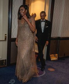 First Lady Michelle Obama makes her entrance at the 2016 WHCD with President Barack Obama. Notice his looking down making sure he doesn't step on her dress, ☺