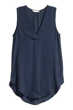 Gently flared, sleeveless blouse in airy crêpe with a V-neck with a pleat centre front and a rounded hem. Slightly longer at the back. The blouse is made partly from recycled polyester. Hippie Chic Fashion, Shirt Blouses, T Shirt, Pregnancy Wardrobe, Casual Outfits, Fashion Outfits, Stitch Fix Outfits, Business Dresses, Western Dresses
