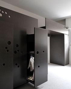 French architect Sandra Courtine of Ciel Architectes has designed a bed unit for a child with circular perforations that form a ladder. The purpose of the unit is to create more usable space and a dedicated children's area in a small room. It incorporates sliding wardrobes and storage space. Circular perforations on a panel of More