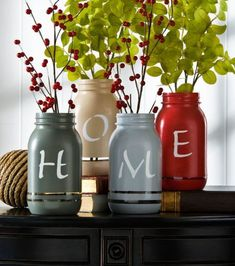 """Use autumnal hues to paint Mason jars, then stencil your word of choice on them. """"Home"""" is displayed here, but we also like """"harvest"""" or """"autumn."""" Get the tutorial at Jo-Ann."""