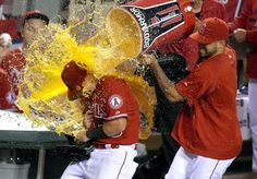 Thirsty? -  Los Angeles Angels' Kole Calhoun is drenched after hitting two home runs in the Angels' 3-0 win over the Boston Red Sox July 18 in Anaheim, Calif. -  © Mark J. Terrill/AP