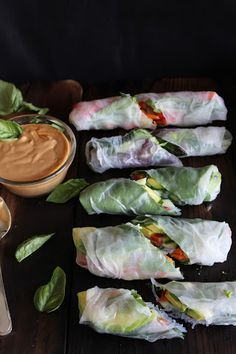 fresh summer rolls with basil, avocado, kale and spicy garlic peanut sauce