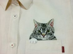 Someone embroiders cats on shirts.  How cool is that?