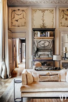 The living room in the Duc de Crillon suite, overseen by Aline D'Amman, showcases the restored hand-painted walls.