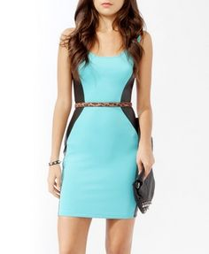 Coated Panel Sheath Dress. Paneled dresses emphasize your curves and slim you down.