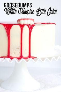 Goosebumps White Vampire Bite Cake - homemade white cake with a vanilla frosting and a blood red white chocolate ganache. Sugar Cookie in cake form? Yes, please.